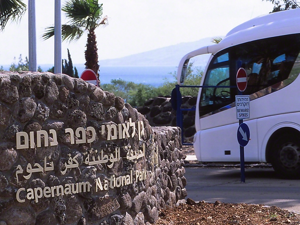 Tour Bus entering Capernum National Park, photographed by Jeff Zablow at Lake Kinneret, Golan Heights, Israel